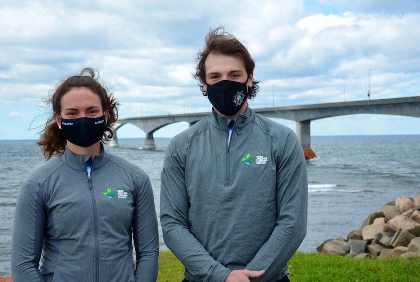 Former Team P.E.I. athletes Sarah MacEachern, left, and Logan MacDougall attended an outdoor event for the 2023 Canada Winter Games at the Marine Rail Historical Park in Borden-Carleton overlooking the Confederation Bridge on Thursday morning. P.E.I.'s two cities – Charlottetown and Summerside – were announced as municipal partners for the 18-day multi-sport event that will take place on P.E.I. from Feb. 18 to March 5.