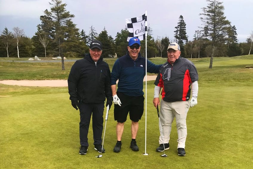 Ron Boland (centre), scored a hole-in-one while golfing recently with his brothers Kevin (left), Leo (right) and Don (not pictured.)