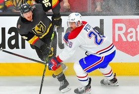 Golden Knights' Patrick Brown shoots the puck past Canadiens defenceman Jeff Petry during second period Wednesday night in Las Vegas.