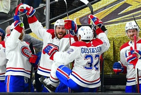 Montreal Canadiens players celebrate on bench after beating the Golden Knights 3-2 in Game 2 of their Stanley Cup semifinal series Wednesday night in Las Vegas.