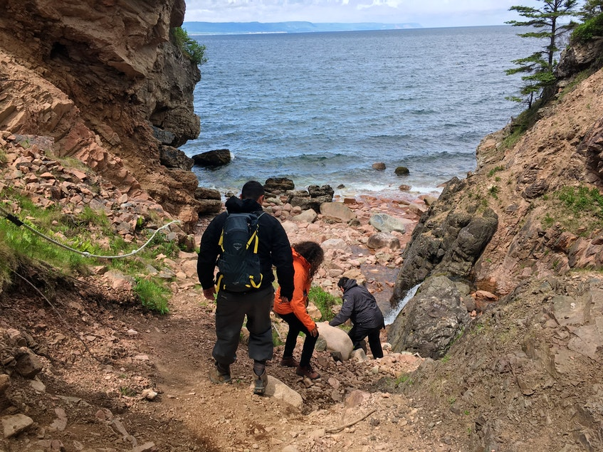Clifford Paul leads the way, while Tara Lewis and Joseph (Joey) Brooks follow closely behind on the steep descent to Kluskap's Cave at the base of Kelly's Mountain. The site is now an Indigenous Protected and Conserved Area. ARDELLE REYNOLDS/CAPE BRETON POST