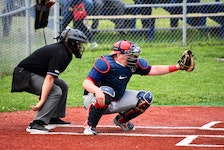Sydney Sooners catcher Sean Ferguson, right, during a Nova Scotia Senior Baseball League game at the Susan McEachern Memorial Ball Park in Sydney in 2019. The senior baseball league anticipates its 2021 season will begin on July 6 in Halifax, pending the easing of COVID-19 restrictions. JEREMY FRASER • CAPE BRETON POST