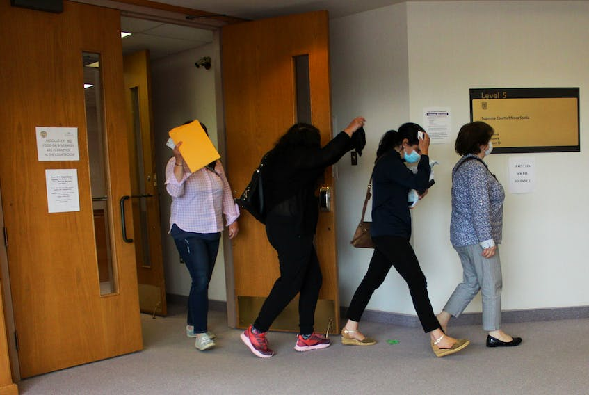 Lydia Saker of Sydney Mines leads her daughters out of a Sydney courtroom Thursday during a break where they are on trial for a $3.6 million tax fraud case. From left, Nadia Saker of Leitches Creek, Georgette Young of Sydney Mines, Angela MacDonald of Kentville and Lydia Saker. CAPE BRETON POST PHOTO