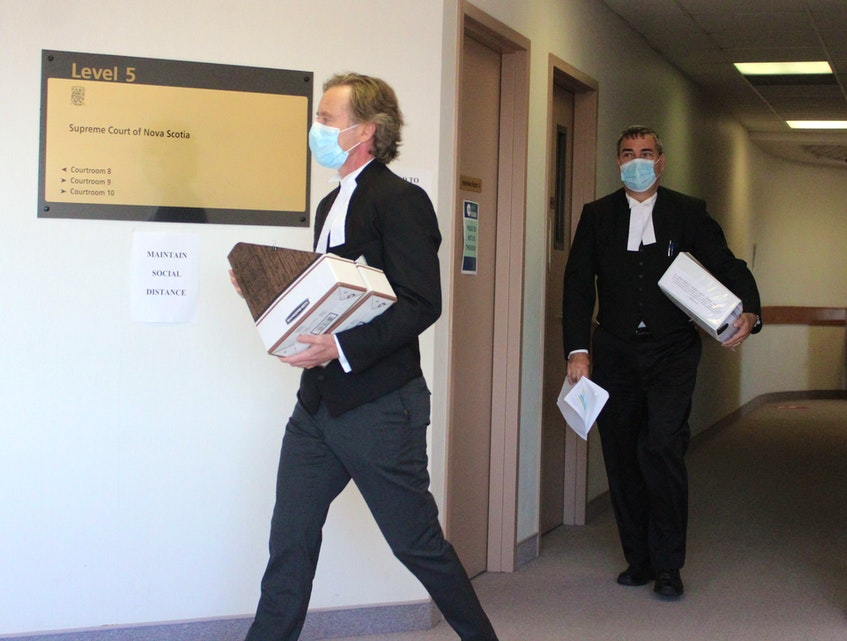 Crown lawyers Mark Donohue, left, and Constantin Draghici-Vasilescu entered a Sydney courtroom Thursday where they are prosecuting a Cape Breton mother and her three daughters in a $3.6 million tax fraud case. CAPE BRETON POST PHOTO