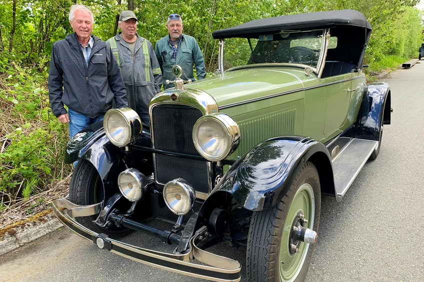 Restorers Brian Beard with brothers Sid and Robert White are proud of how the 1926 Nash Advanced Six roadster turned out. Alyn Edwards/Postmedia News - POSTMEDIA