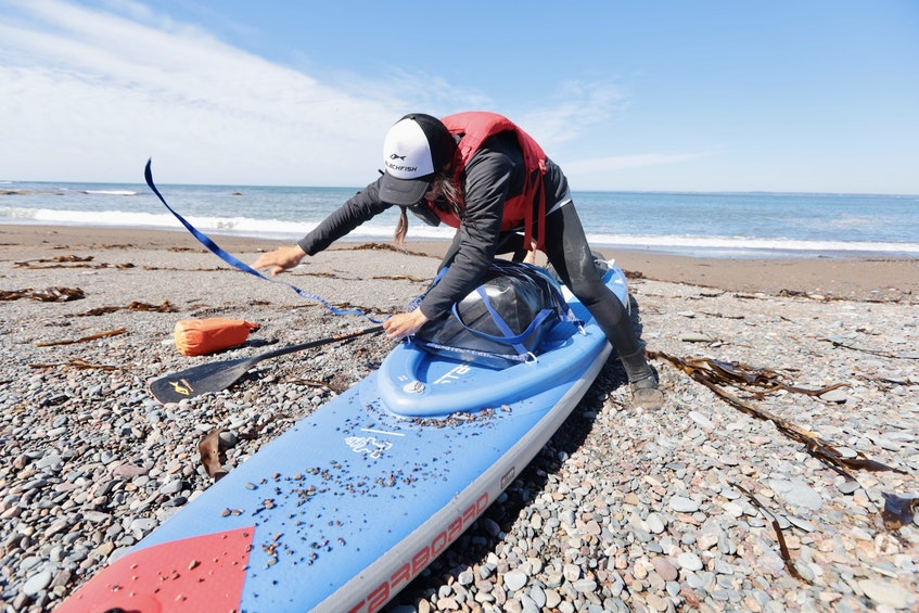 Mariele Guerrero prepares for the next leg of her 1,500-kilometre journey after making a stop at Half Island Point, near Lawrencetown on Friday. - Eric Wynne