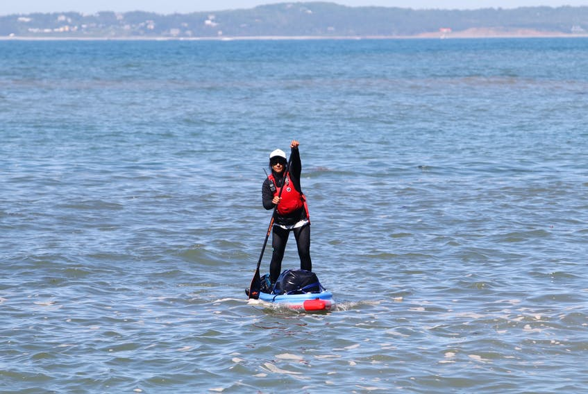 Mariele Guerrero checks the swell on her stand up paddle board for the next leg of their journey after making a stop around Half Island Point, near Lawrencetown Friday. Guerrero is circumnavigating around Nova Scotia, a 1,500-kilometre trip around mainland Nova Scotia on a stand-up paddleboard.