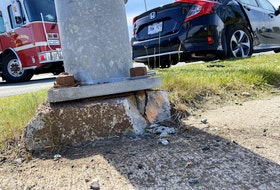 The concrete at the base of a traffic light at the intersection of Allandale Road and the Prince Philip Drive in St. John's was damaged in a motor vehicle collision on June 18, 2021.
