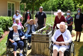Members of the Garden Club and staff come together for a photo while surrounded by some of their green thumb handiwork. Pictured are Helen Dearman (back, left), Louela Paris, Wayne White, Shelly DeViller, Stephanie Miles, Jean Partridge (middle, left), Joan Dempsey, Edna Gregory, Elaine McNamara (front, left), and Loretta Sullivan.