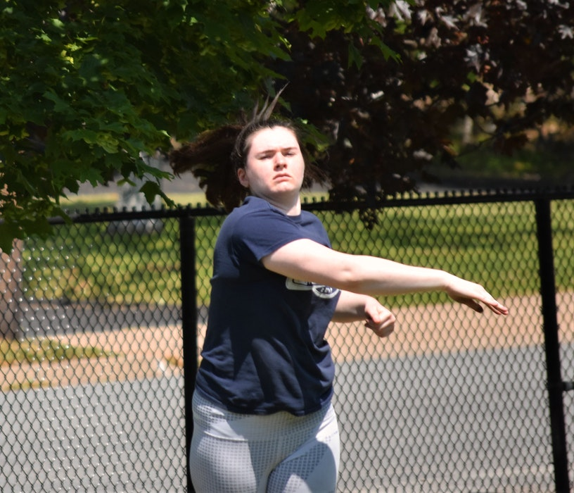 Chelsea MacIsaac, from the Truro Lions, follows the flight of her shot-put throw during a recent training session at the TAAC Grounds. - Richard MacKenzie
