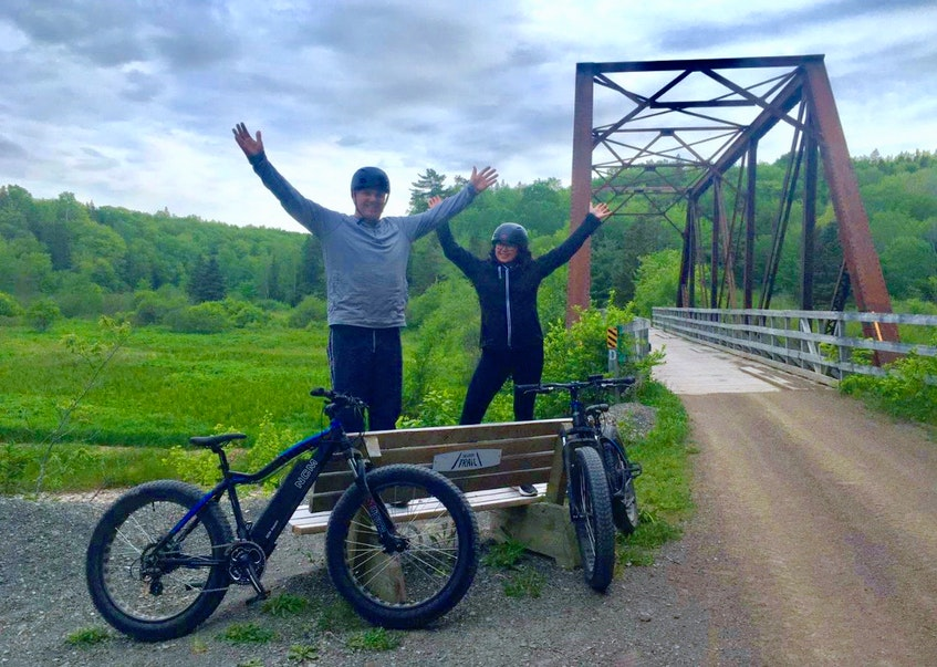 Jan and Brenda van Zutphen enjoying the trail near the Juicy Apple Bridge. CONTRIBUTED