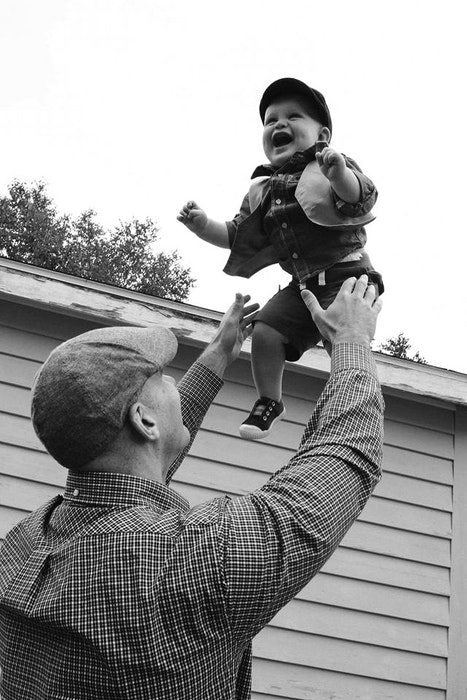 Donnie Green throws his then baby son Anderson in the air. CONTRIBUTED/LEEBLY BROWN