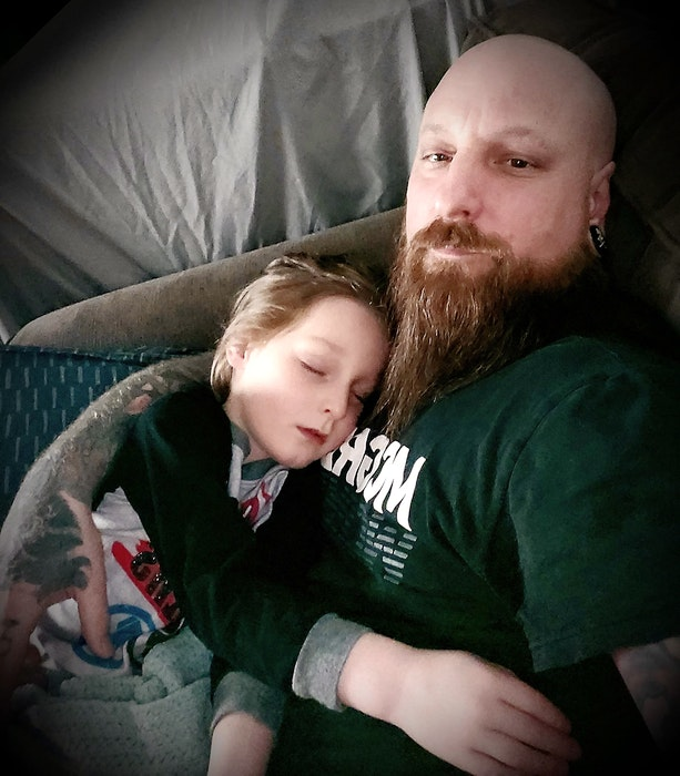 Alex Ste. Marie hold his five-year-old son Silas, who wasn't feeling well, in his arms in this photo from February. NICOLE SULLIVAN/CAPE BRETON POST