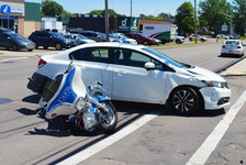 A collision involving a Charlottetown Police Services motorcycle and a white Honda Civic occurred on Friday, June 18, at the corner of Queen and Pond streets. Police had a section of Queen Street closed for the early part of the afternoon.