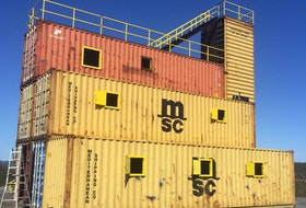 This stack of shipping containers has been turned into a training facility for the Corner Brook Fire Department. The project cost $76,740.74 more than budgeted for.