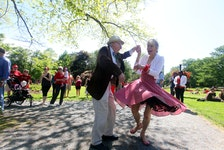 July 1, 2015--Ted Worthington and Lana Pinsky do a little dancing as they listen to Roxy and The Underground Soul Sound at the bandshell in the Publilc Gardens Wednesday. (ERIC WYNNE/Staff)