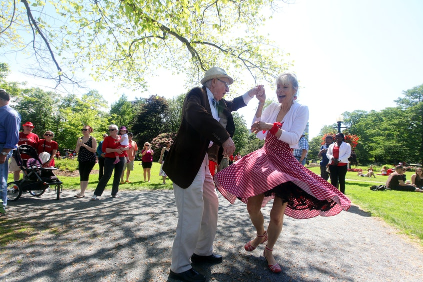 Ted Worthington and Lana Pinsky do a little dancing as they listen to Roxy and The Underground Soul Sound at the bandshell in the Public Gardens on July 1, 2015. - Eric Wynne