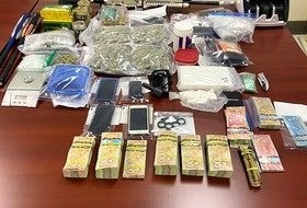 Police conducted a warrant search at home in Virgin Arm and seized several kilograms of various drugs, weapons and cash on June 16.