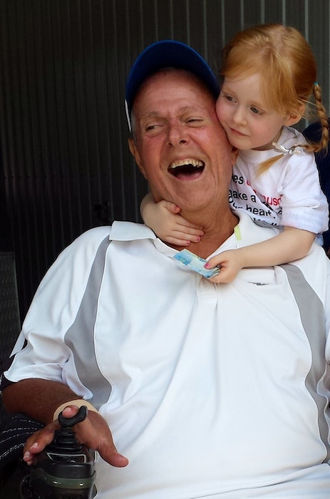 Lily MacDonald gives her beloved grandfather, Bernie McKeough, a hug in this 2015 photo. Now nine years old, Lily has raised over $10,000 in her grandfather's memory for Muscular Dystrophy. McKeough, had been Pictou County's largest fundraiser for Muscular Dystrophy, a disease he had lived with until he passed away. - Contributed