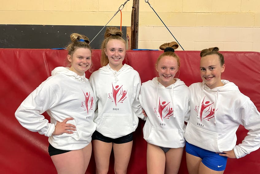 Four members of the Island Gymnastics Academy take a break from training this week as they prepare for the (Virtual) National Gymnastics Championships, which get underway today. From left, are Sophie Mayne,Ella MacDougall, Victoria Covey and Callie Harding. In the absence of a physical in-house Nationals due to the COVID-19 pandemic, gymnasts will be judged via submitted video. The gymnasts are coached by Shelley Ferguson, Janet Duval and Janice Hicks.