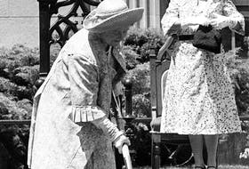 The Queen Mother, on the front lawn of the Memorial Library in Halifax on June 28, 1979, turns the sod for a sculpture of Winston Churchill that was scheduled to be placed at the library in the fall. Janet F. Kitz   looks on.- The Canadian Press