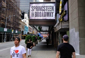 People walk past the St. James Theatre after it announced Bruce Springsteen's return to Broadway on June 26th with 'Springsteen on Broadway' on June 11, 2021 in New York City.