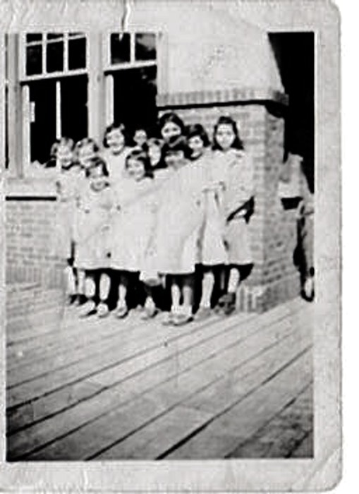 Young girls wait at a P.E.I. train station to be taken to the residential school in Shubenacadie, N.S. - Contributed