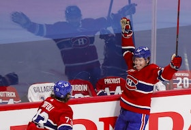 Canadiens' Cole Caufield celebrates his goal against Vegas Golden Knights with Tyler Toffloi during the second period of the National Hockey League playoff game in Montreal on Friday, June 18, 2021.