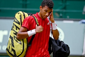Félix Auger-Aliassime of Canada looks dejected after losing his match against Ugo Humbert of France during day 8 of the Noventi Open at OWL-Arena on June 19, 2021 in Halle, Germany.