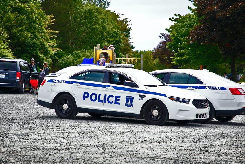FOR CAMPBELL STORY: A pair of Halifax Regional Police officers confer in their cars, in the parking lot of Africville Park in Halifax Saturday June 19, 2021....For Campbell story on BOPC subCommittee to define defunding the police story.