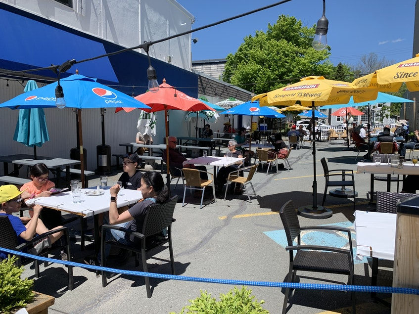 Patrons enjoy a nice day outside Athens restaurant on Quinpool Road on Wednesday as Nova Scotia's COVID-19 restrictions eased to allow service outside. - Stuart Peddle