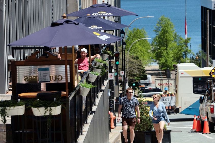 The outdoor patios along Argyle Street were buzzing with activity and patrons at the first day of dining on patios was allowed in some time. It was also perfectly timed thanks to sunny weather. - ERIC WYNNE/CHRONICLE HERALD