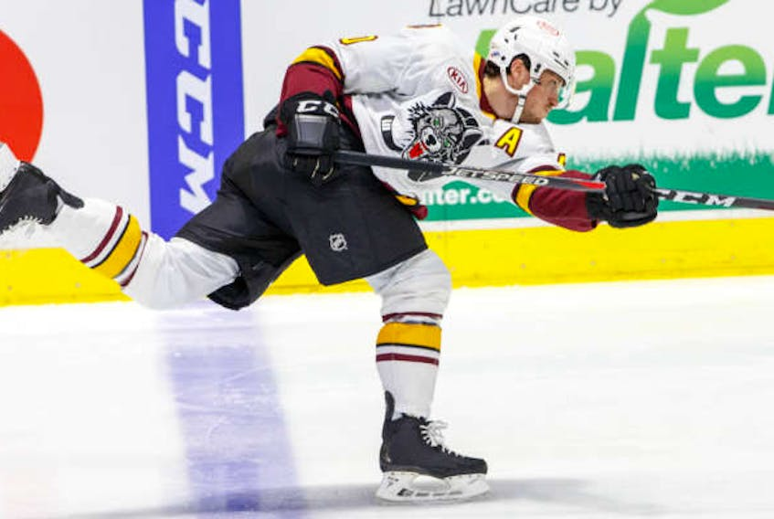 Cavan Fitzgerald, who played his under-18 hockey with the Cape Breton Unionized Tradesmen, takes a shot from the blueline during American Hockey League action with the Chicago Wolves during the 2020-21 season. Fitzgerald recently signed with the Carolina Hurricanes franchise. CONTRIBUTED • CHICAGO WOLVES
