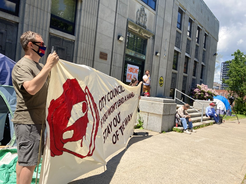 Halifax Mutual Aid built 13 temporary crisis shelters in the city and is opposing the city's plans to remove the wooden structures. The group held a rally on Sunday at Halifax's old library on Spring Garden Road where several of them are located. Group spokesman Campbell McClintock told the crowd that it won't remove the shelters until the city finds long-term housing for the hundreds of homeless in the region. - Andrew Rankin