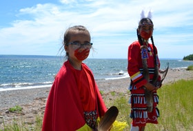"""Piper McDonald, seven, and Leannah Joe, 10, take part in the video for the song """"I Want to Rise,"""" a song to honour missing and murdered Indigenous women and girls in Canada, written by band teacher Carter Chaisson and performed by Grade 12 student Emma Stevens. ARDELLE REYNOLDS/CAPE BRETON POST"""