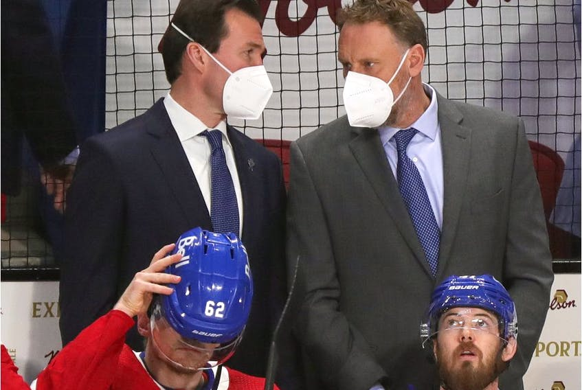 Canadiens assistant coach Luke Richardson (left) and director of goaltending Sean Burke talk behind bench during Game 3 of Stanley Cup semifinal series against the Vegas Golden Knights at the Bell Centre. Richardson made his NHL head-coaching debut in the game, filling in for Dominique Ducharme, who tested positive for COVID-19.