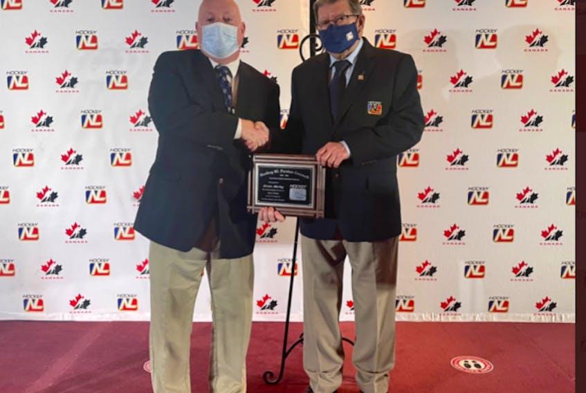 North River's Brian Hurley (left) receives his 2021-Hockey NL Junior Hockey Merit award during the HNL awards ceremony held in Gander on June 12. Shown here with Brian is Hockey NL junior director Charlie Kearsey.