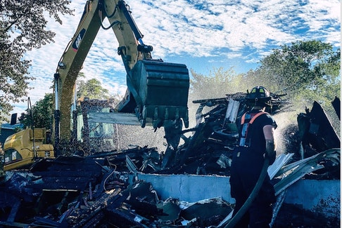 The vacant structure at 133 Tobin Avenue was demolished Saturday morning following a suspicious fire. The burnt structure remaining was deemed unsafe and fire chief Lloyd MacIntosh said it had to be demolished immediately. CONTRIBUTED/NORTH SYDNEY FIRE DEPARTMENT