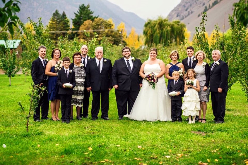 Bride and groom, David and Jennifer Kyte, with their family at their wedding five years ago. From left, Laurie Koblun, Crystal Chartrand, Jaxon Koblun, Corinne Chartrand, Greg Chartrand, Lance Chartrand, David and Jennifer, Alison Kyte, John Pushor, Judy and Wayne Kyte, and front row from left, Harvey and Stella Pushor. - Contributed
