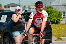 Simon Pont is all smiles as he begins his 1,000-km ride to beat prostate cancer in Clark's Harbour on June 20. His daughter Rachel captures the moment with her phone. KATHY JOHNSON • TRICOUNTY VANGUARD