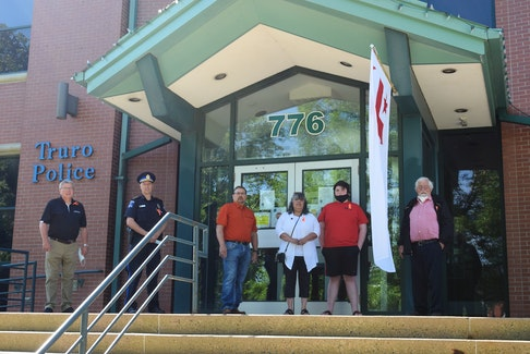 Community representatives gathered to commemorate National Indigenous Peoples Day in front of the Truro Police Station. Left to right: Truro Mayor Bill Mills, Truro Police Chief Dave MacNeil, Millbrook First Nation Chief Bob Gloade, Native Council of Nova Scotia Chief and President Lorraine Augustine, youth Landon Higgins and Maritime Aboriginal Peoples Council Director and elder Roger Hunka.