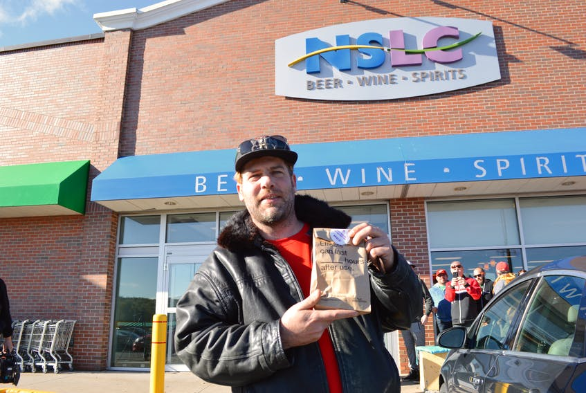 Renowned Cape Breton fiddler Ashley MacIsaac was the first customer to purchase cannabis at the Nova Scotia Liquor Corporation's Sydney River outlet after waiting outside the Keltic Plaza location the entire night before marijuana became legal in Canada on Oct. 17, 2018. CAPE BRETON POST FILE PHOTO