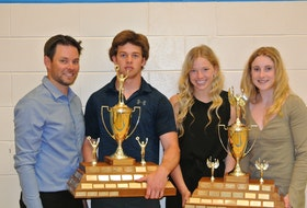 Westisle Composite High School athletic director Brett Corcoran, left, offers congratulations to the 2020-21 athletes of the year. From second left: Chandler DesRoches, male athlete of the year; Megan Kinch, co-female athlete of the year, and Heidi Thibodeau, co-female athlete of the year.