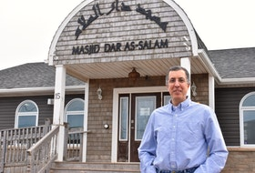 Zain Esseghaier stands outside the Masjid Dar As-Salam mosque in April 2020. Michael Robar/The Guardian