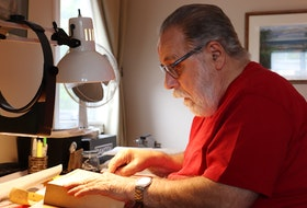 Clair Smith sits at his woodcarving station in his Charlottetown home.
