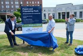 FOR NEWS STORY: Halifax Mayor Michael Savage,  Daniel Paul, a Mi'kmaw elder and historian and councilor Waye Mason unveil the sign during a renaming ceremony of Peace and Friendship Park in Halifax Monday June 21, 2021. Mason and Paul were both members of the task force for the former Cornwallis statue.   TIM KROCHAK PHOTO