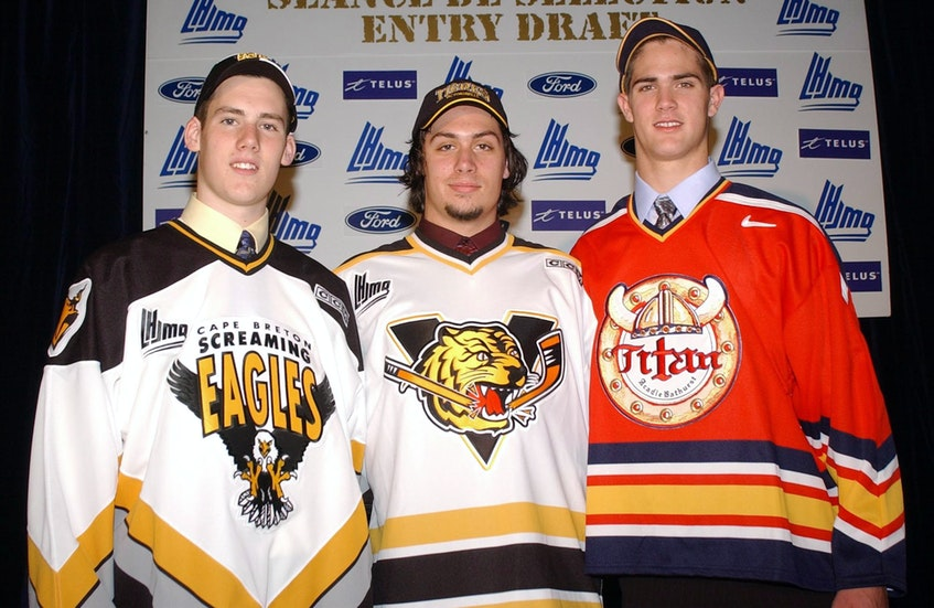 James Sheppard, left, with Jason Legault and Alex Lamontagne following the opening round of the 2004 Quebec Major Junior Hockey League Entry Draft in Baie-Comeau, Que. Sheppard was taken first overall by Cape Breton, while Lamontagne was selected second overall by the Acadie-Bathurst Titan and Legault was chosen third overall by the Victoriaville Tigres. CONTRIBUTED - Contributed