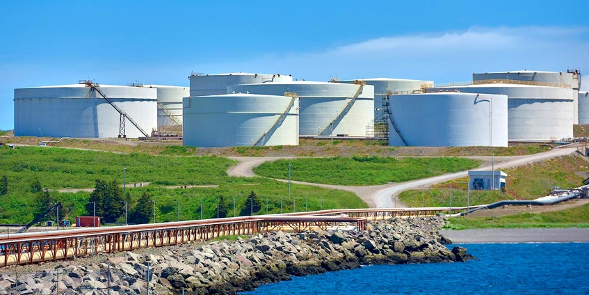 Storage tanks at the Come By Chance oil refinery. - File