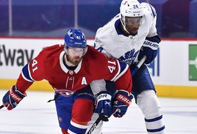 Paul Byron (left) of the Montreal Canadiens skates against the Leafs' Wayne Simmonds of the Toronto Maple during their first-round series.