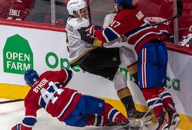 Canadiens' Paul Byron  and rJosh Anderson crunch Golden Knights defenceman Zach Whitecloud Sunday night at the Bell Centre. Anderson led the team with 10 hits in the contest.